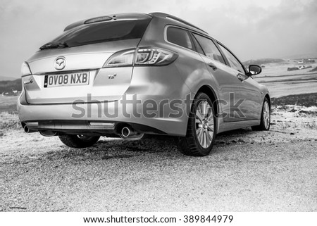 Dunvegan, Isle of Skye, Scotland - March 15, 2015 - Private Car Mazda 6 GH Estate 2007 - 2012 photo session near Loch Dunvegan overseeing pier and small fishing village