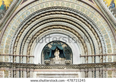 Duomo Cathedral portal  with Statue Mary (Saint Mary or Virgin Mary) and the Jesus, Orvieto, Umbria, Italy