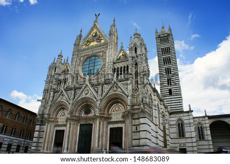 Duomo of Siena, Tuscany, Italy. Siena cathedral against a bright blue sky