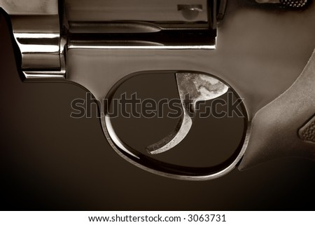 Duotone close-up photo of a gun trigger - stock photo