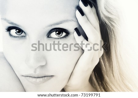 Duotone colored close-up portrait of young girl with beautiful eyes - stock photo