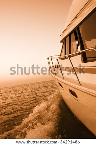 Duotone image of a boat on a lake at sunset - stock photo