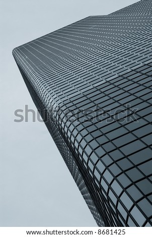 Duotone image of a modern office building from ground perspective - stock photo