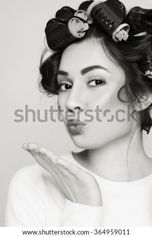 Duotone portrait of young beautiful girl in thermal hair rollers - stock photo