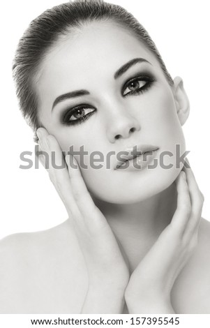 Duotone portrait of young beautiful woman with stylish make-up over white background - stock photo