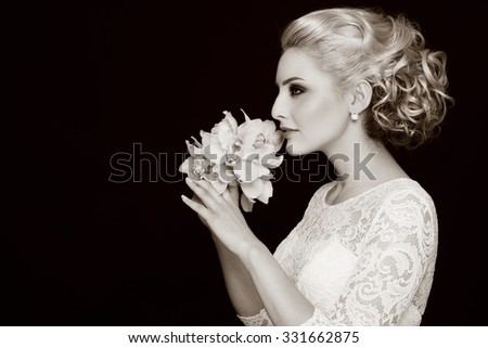Duotone profile portrait of young beautiful bride with stylish prom hairdo - stock photo