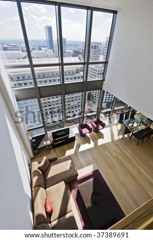duplex apartment with two floors large windows and city views - stock photo