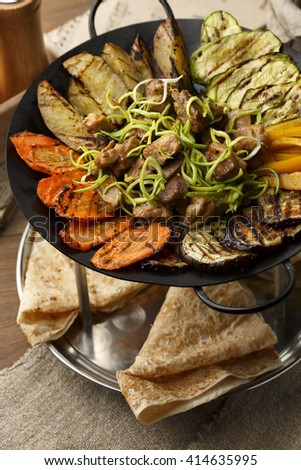Duplex tray with meet, vegetables and pancakes. - stock photo