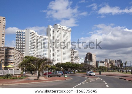 "DURBAN, SOUTH AFRICA - DECEMBER 6 2013: Residential complexes on Durbans ""Golden Mile"" beachfront on December 6 2013 in Durban South Africa"