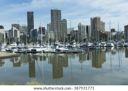 Durban, South Africa - 13 January 2016: Early morning view of yachts moored at yacht mole against Durban City Skyline in Durban South Africa