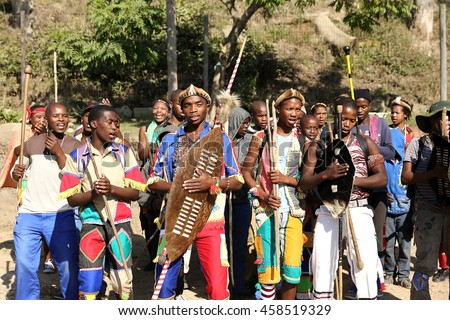 DURBAN, SOUTH AFRICA - June 4: A group of men dressed in traditional Zulu clothing perform at a ceremony in Kwa Zulu Natal, South Africa on June 4, 2016.