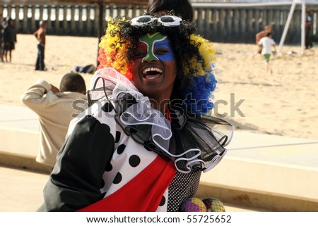 DURBAN, SOUTH AFRICA - JUNE 17: Colorful entertainer delights visitors from around the world outside FIFA fan park June 17 2010 Durban beach front South Africa. - stock photo
