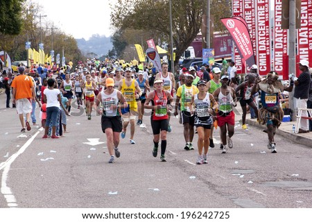 DURBAN, SOUTH AFRICA - JUNE 1, 2014: Many Competitors and traditionally Decorated runner compete in the long distance Comrades Ultra Marathon between Pietermaritzburg and Durban in South Africa.