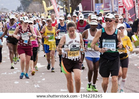 DURBAN, SOUTH AFRICA - JUNE 1, 2014: Many unknown runners compete in the long distance Comrades Ultra Marathon between Pietermaritzburg and Durban in South Africa.