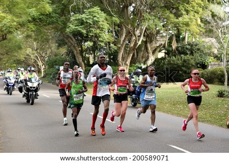 DURBAN, SOUTH AFRICA - JUNE 1: Twin sisters Olesya and Elena Nurgalieva lead the womens race going through Kloof in the 2014 Comrades Marathon in Durban South Africa on June 1, 2014.  - stock photo