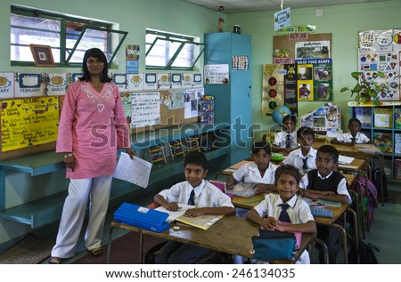 Durban, South Africa - March 10 2010: A classroom with teacher of  the Everest indian primary school in the Shalcross quarter - stock photo