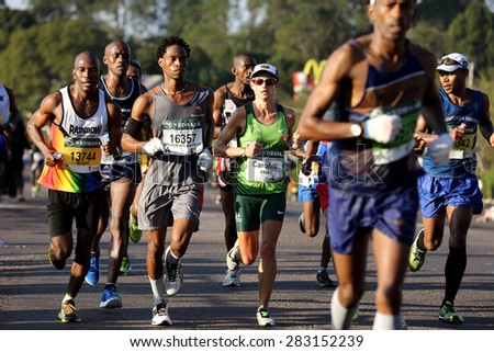 DURBAN, SOUTH AFRICA â?? MAY 31: Caroline Wostman leads the ladies race through Hillcrest and went on to win the 2015 Comrades marathon Up run in Kwa Zulu Natal, South Africa on May 31, 2015.  - stock photo
