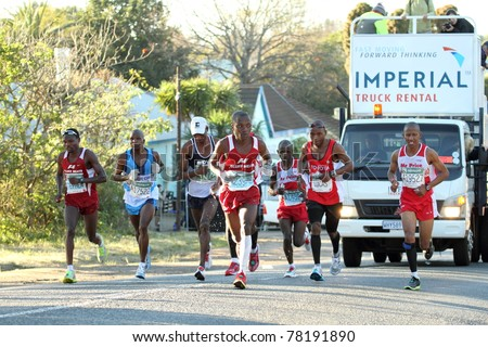 DURBAN, SOUTH AFRICA - MAY 29:  Stephan Muzchingi, far left, going for his third consecutive win as front runners in the Comrades marathon approach the halfway mark on the May 29, 2011 in Durban, South Africa. - stock photo