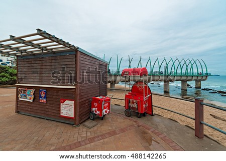 DURBAN, SOUTH AFRICA - SEPTEMBER 10, 2016: Kiosk at Umhlanga Rocks Beach with Millennium Pier in the background