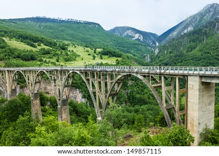 Durdevica Tara concrete arc bridge in the mountains, North of Montenegro. One of the highest automobile bridges in Europe.   - stock photo