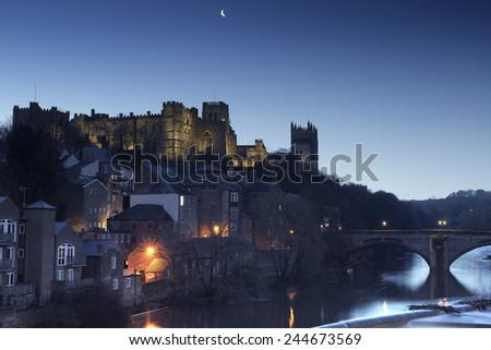 Durham just before sunrise. The Castle, Cathedral, Framwellgate Bridge and River Wear are visible. - stock photo