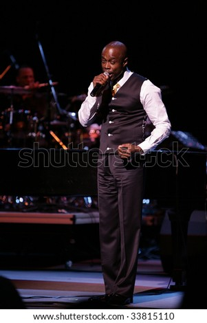 DURHAM, NORTH CAROLINA-MAY 10: Kem Owens singer performs on stage at Durham Performing Arts Center on May 10, 2009 in Durham, North Carolina. - stock photo
