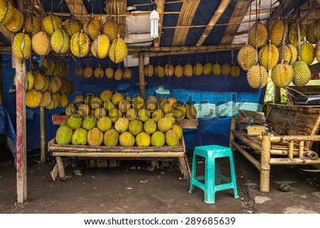 """Durian fruits street market stall, Sumatra, Indonesia. Durian regarded by many people in southeast Asia as the """"king of fruits"""" - stock photo"""