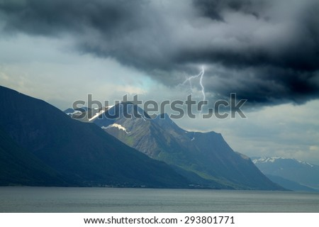 during a storm in the mountains lightning. clouds like fog - stock photo