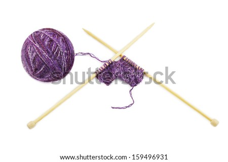 during knitting,skein and knitting needles isolated on white background - stock photo