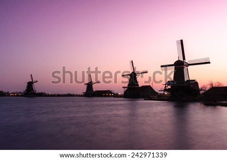 During sunrise at famous windmill in Zaandam near Amsterdam, Netherlands - stock photo
