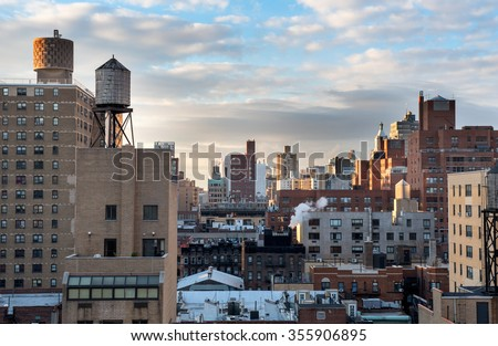 During sunrise the rooftops of Manhattan were bathing in a beautiful light - stock photo