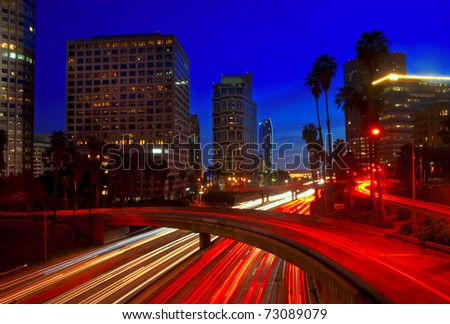 During the blue hour, rush hour traffic in downtown Los Angeles, California.