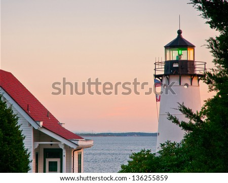 During the Prohibition Era, bootleggers were caught near Warwick Harbor Lighthouse operating nearby. - stock photo
