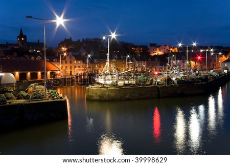 Dusk at picturesque fishing harbour of Pittenweem, East Neuk, Fife, Scotland, UK, Europe, - stock photo