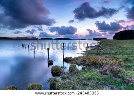 Dusk at the Crowdy Reservoir near Davidstow on Bodmin Moor in Cornwall - stock photo