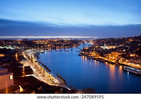 Dusk at the Douro river in cities of Porto and Vila Nova de Gaia in Portugal. - stock photo