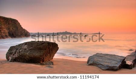 Dusk by the ocean - stock photo