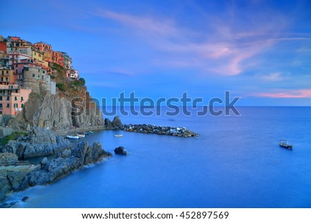 Dusk image of the old village of Manarola above the sea, Cinque Terre, Italy - stock photo