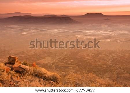dusk settling over the vast plains of the Karoo in South Africa - stock photo