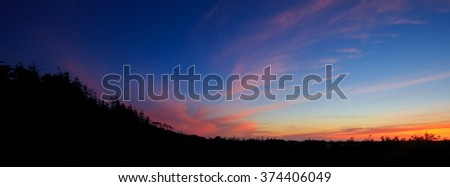 Dusk sunset photo with a colorful sky on a beach in Oregon. - stock photo