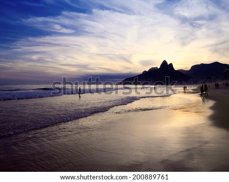 Dusk sunset reflection of Rio de Janeiro Ipanema Beach Brazil with Two Brothers Mountain skyline - stock photo