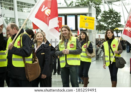 Dusseldorf Airport, Dusseldorf, Germany:  March 21, 2013. Queues of people form in front of check in desks due to a strike in Dusseldorf airport.Lufthansa employees on strike. - stock photo
