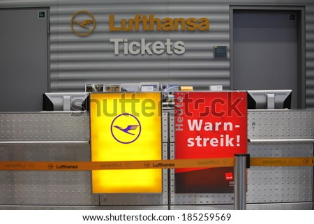 """Dusseldorf Airport,Germany.March 21, 2013. Lufthansa's counters with """"strike"""" sign at Dusseldorf airport.Lufthansa employees on strike.  - stock photo"""