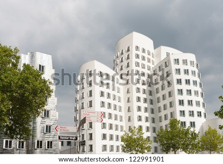 DUSSELDORF, AUGUST 11: Media Harbor area on august 11, 2012 in Dusseldorf. This building complex was designed by Frank O. Gehry and completed in 1998. There are three versions: white, red and silver.