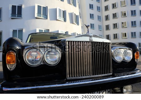 DUSSELDORF, GERMANY - APRIL 7, 2013: A front view of a Rolls-Royce Silver Shadow in the media harbor district on April 7, 2013 in Dusseldorf. - stock photo