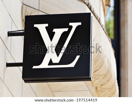 Dusseldorf, Germany - August 20, 2011: Louis Vuitton logo at the store on Koenigsallee. Louis Vuitton Malletier is a french fashion house and well-known for its LV monogram. - stock photo