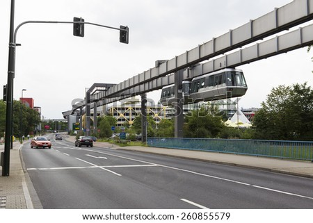 DUSSELDORF, GERMANY- JULY 5, 2012: Public transportation system Sky-Train hanging from elevated guideway beam on columns in Dusseldorf, Germany. The SkyTrain, takes passengers to the airport terminal. - stock photo