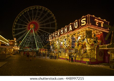 Dusseldorf, Germany - July 21, 2014: View of Summer fun fair in Dusseldorf at late evening.