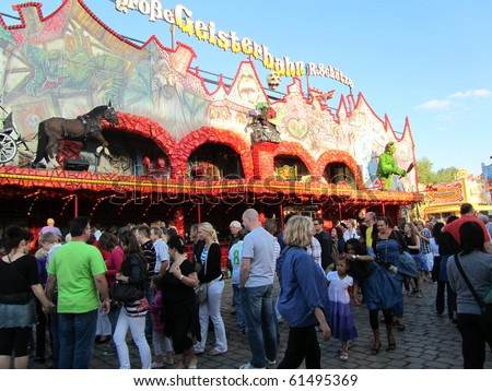 DUSSELDORF, GERMANY - JULY 24: Visitors at Ghost Train Ride at Kirmes on July 24, 2010 in Dusseldorf, Germany. Kirmes is the biggest summer fair on the north Rhein in Germany. - stock photo