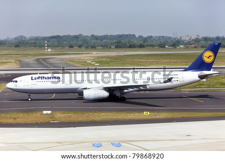 DUSSELDORF, GERMANY - MAY 21: Airbus A330 lands on May, 21 2011 in Dusseldorf airport, Dusseldorf, Germany. Lufthansa services around 410 destinations with over 710 aircraft. It has the second airline fleet in the world